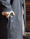 Gunfighter is ready has his thumb on the hammer and his finger on the trigger to draw Royalty Free Stock Photos