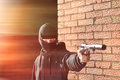 Gunman in black mask holding gun with silencer Royalty Free Stock Photography