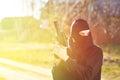Gunman in black mask holding gun with silencer Royalty Free Stock Images