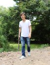 The gunner man holding long gun in hand with white shirt and denim jean. Royalty Free Stock Photo