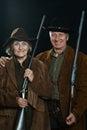 Gunslingers in western garment happy on black Royalty Free Stock Images