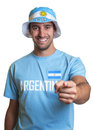 Guy with argentinian jersey and hat pointing at camera Royalty Free Stock Photo
