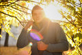 Guy backlight portrait against an autumn tree in a park young Royalty Free Stock Photos