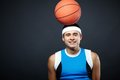 Guy with ball portrait of handsome in sportswear basket on his head looking at camera Stock Photos