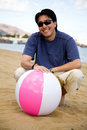 Guy with a beachball Royalty Free Stock Photo