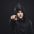 Guy in the black robe indicates you Royalty Free Stock Photo