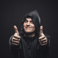 Guy in a black robe showing thumbs up smiling Royalty Free Stock Photo