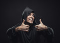 Guy in a black robe showing thumbs up smiling Stock Images