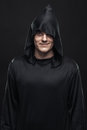 Guy in a black robe smiling Royalty Free Stock Photo