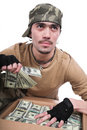 The guy in a camouflage and with a box of money Stock Photography