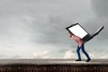 Guy carrying laptop Royalty Free Stock Photo