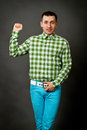 Guy in a checkered shirt young on gray background Royalty Free Stock Image