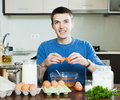 Guy cooking scrambled eggs Royalty Free Stock Photo
