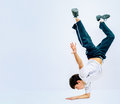 Guy dancing breakdance the dark haired boy standing on his hand he dances Stock Images