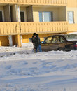 Guy digs car out of the snow from snowdrift Stock Photos