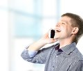 Guy enjoying a conversation over the cellphone young Royalty Free Stock Image