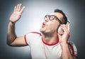 Guy enjoying in music young trendy man dancing and listening with headphones over dark gray background studio shot Stock Photos