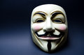 Guy fawkes mask on black background symbol of recent underground movements such as anonymous the hacker group also used in the Stock Photos