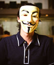 Guy fawkes mask a portrait of a man wearing a Royalty Free Stock Photos