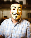 Guy fawkes mask a portrait of a man wearing a Stock Photo