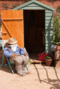 Guy and the Garden Shed Stock Images
