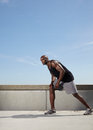 Guy gets ready to run outdoors full length image of fit and strong young male model for his muscular male athlete Stock Images