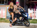Guy and girl on motorbike phangan january unknown january in koh phangan thailand thailand is a magnet for travellers the world Stock Image