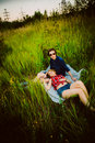 Guy and the girl sitting in the grass Royalty Free Stock Photo