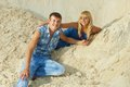 Guy and girl in white sand couple lovers happy on blue clothes Royalty Free Stock Images