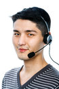 Guy with a headset young man wearing call center Stock Photo