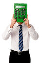 Guy hiding his face behind big calculator man holding in front of Stock Images