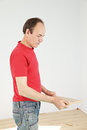 Guy holding plank Stock Photography