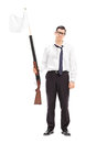 Guy holding a rifle with white flag attached on it full length portrait of sad isolated background Stock Image