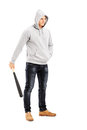 Guy with hood over his head holding a baseball bat full length portrait of symbolizing crime isolated on white background Royalty Free Stock Photography