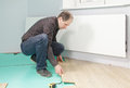 Guy installing flooring Stock Photos
