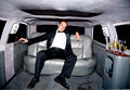 Guy in a limousine Stock Photo