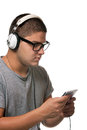 Guy listening to music a young man listens with a set of head phones while examining the album cd case Stock Photos
