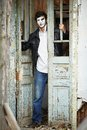 Guy mime against the old wooden door. Stock Photography