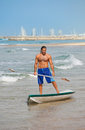 The guy with an oar on a surfboard. Stock Photography