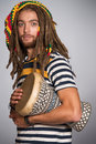 Guy rastafarian portrait of a playing his drum Royalty Free Stock Images