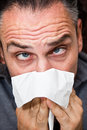 Guy with a runny nose Stock Image