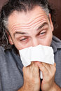 Guy with a runny nose Stock Photography