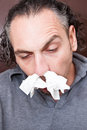 Guy with a runny nose Stock Images