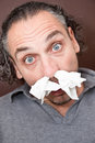 Guy with a runny nose Royalty Free Stock Images