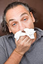 Guy with a runny nose Royalty Free Stock Photos