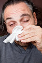 Guy with a runny nose Stock Photo