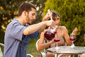 Guy serving sangria with friends in a terrace couple of drinking and outdoors Stock Image