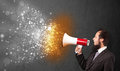 Guy shouting into megaphone and glowing energy particles explode Royalty Free Stock Photo