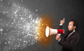 Guy shouting into megaphone and glowing energy particles explode concept Royalty Free Stock Images
