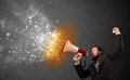 Guy shouting into megaphone and glowing energy particles explode concept Stock Photos